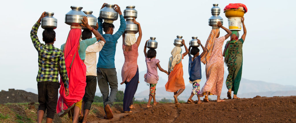 Carrying water on their heads