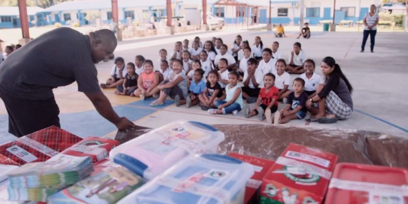 76 students received gift-filled shoeboxes at the first Operation Christmas Child outreach event at the western Pacific island nation.